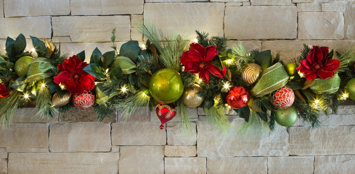 Traditional red, green, and gold ornaments with textured greenery accenting the colors even more beautifully.